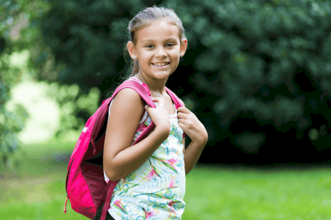 Little girl with a pink backpack