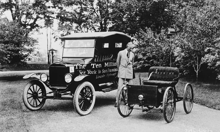 Ford Motor Company's first and ten millionth car sit side by side in an exterior shot.