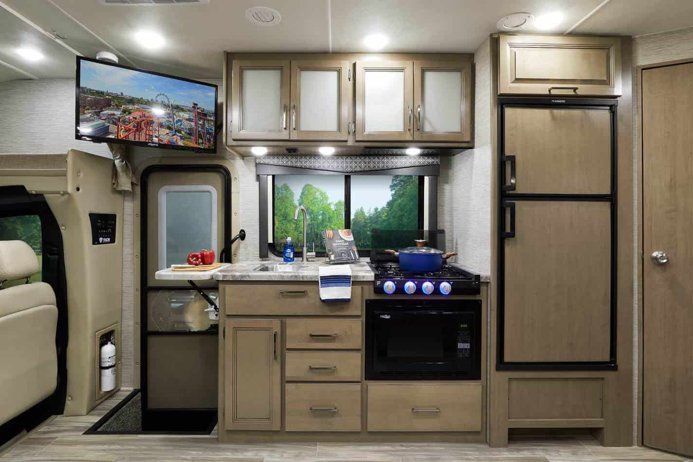 Interior view of RV kitchen in a Class A motorhome
