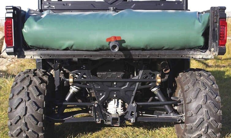 Portable water reservoir bag on the back of an off-road vehicle.