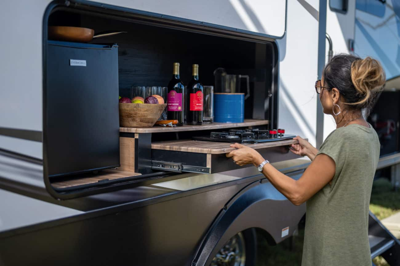 woman using an RV outdoor kitchen