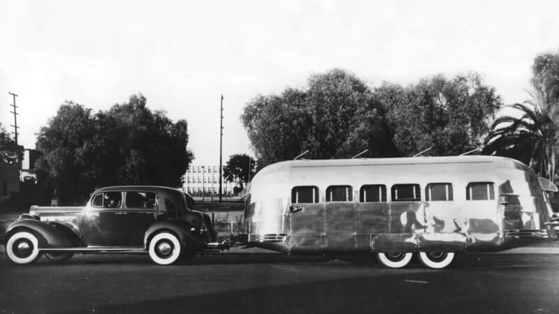 Black and white image of vintage Airstream being towed