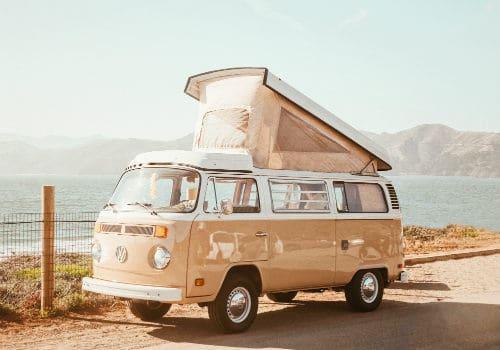 Brown vintage van near water at daytime