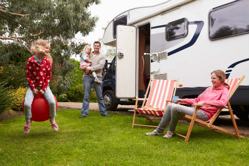 Family enjoying camping holiday