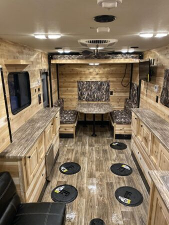 Rugged Interiors and ice fishing holes are hallmarks of fish house RVs - Photo: Glacier Ice House