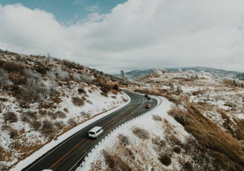 Man in the road near RV in winter