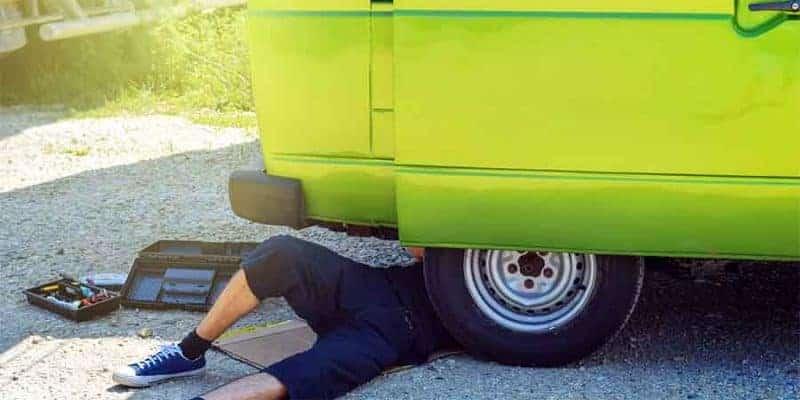 Man repairing his RV