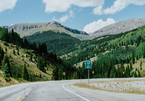 Road with street sign overlooking mountain