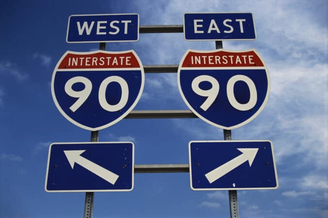 This is a road sign on the New York State Freeway. It points out the direction for Route 90 to go east or west.