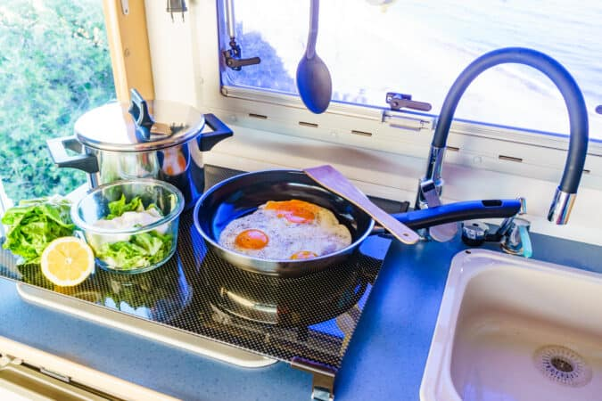 Crowded cooktop in a small RV kitchen