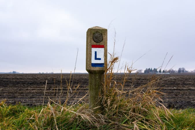 An original Lincoln Highway road markers in rural Illinois.