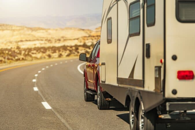 Travel Trailer Pulled by Modern Pickup Truck on a Scenic Utah Route