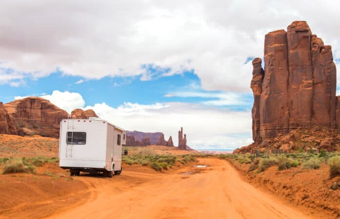 RV parks in Monument Valley on dirt road.
