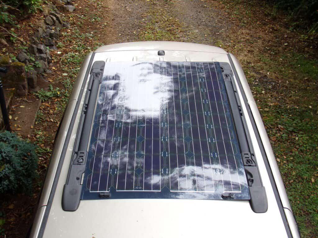 Lightweight, flexible solar panels on the roof of a mini van