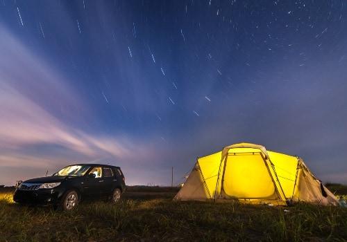 Subaru forester at beach camping under a night sky
