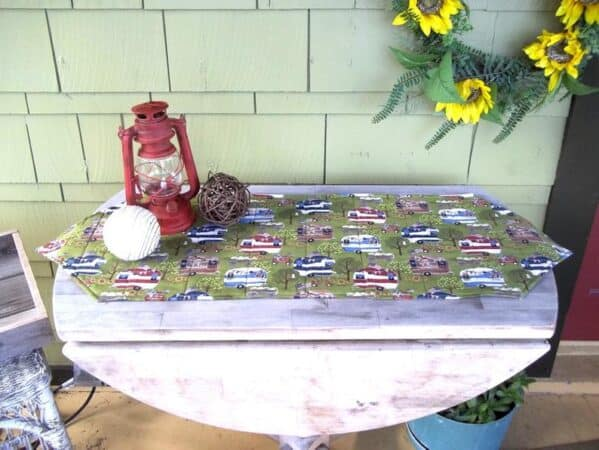 Small table with custom RV table runner.