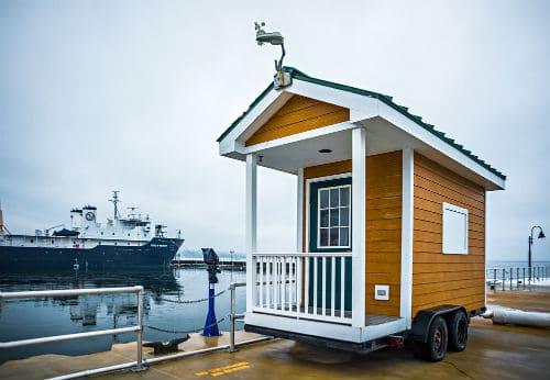 Tiny house shed on wheels near lake