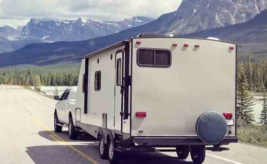 Truck towing camper