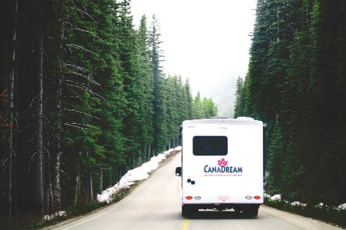 White camper on road during daytime