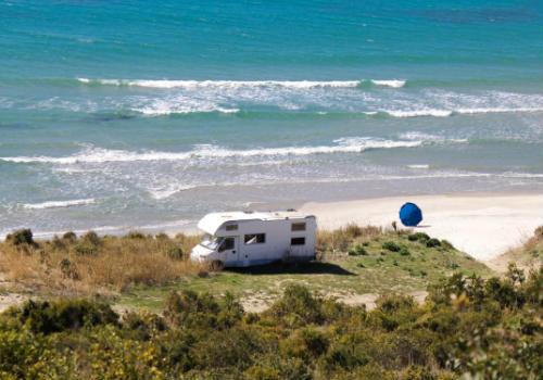 White RV near the ocean