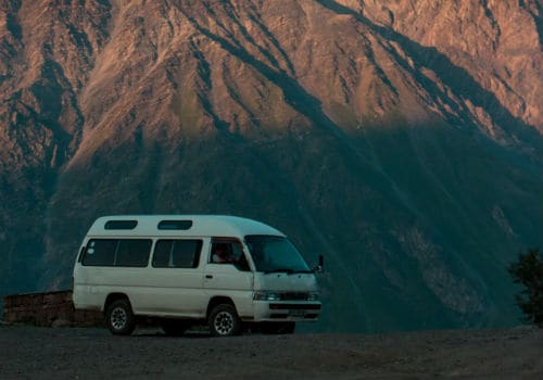 White van near mountain