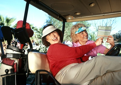 women are laughing in the golf cart